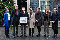 London, UK. 3rd December, 2018. A group including People's Vote spokesman Chuka Umunna MP, Caroline Lucas MP, Justine Greening MP, co-founder of Our Future Our Choice Lara Spirit and editor of the Independent Christian Broughton delivers a Final Say petition signed by over a million people to 10 Downing Street to be presented to Prime Minister Theresa May following her return from the G20 summit in Buenos Aires.
