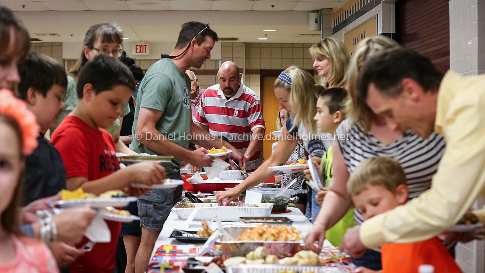 (6/14/16, UPTON, MA) People sample foods from around the world during International Night at Nipmuc High School in Upton on Tuesday. Daily News and Wicked Local Photo/Dan Holmes