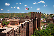 Silves, Algarve, Portugal, June 2014. Silves is a picturesque village with cobble stone streets overlooked by a Moor Castle, castelo dos mouros. A spectacular coastline of steep sandstone cliffs borders hidden sandy beaches on the south western tip of Europe, where the Mediterranean becomes the Atlantic Ocean.  Photo by Frits Meyst / MeystPhoto.com