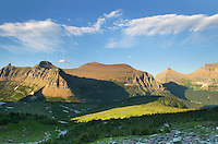 Alpine meadows at Logan Pass with the Garden Walll and Piegan Mountain in the distance, Glacier National Park Montana USA
