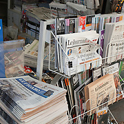 foreign newspapers and magazines at a newspaper stand