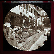 'Espartería en Almería' 1890 photographers Hermenegildo Otero and Miguel Aguirre, circular magic lantern slide mis-captioned as Barcelona, Spain. Women basket weavers and rope makers sitting in market place. Thought to be Cordoba.