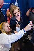 Former CEO and GOP presidential hopeful Carly Fiorina takes a selfie with a supporter following the National Security Forum with the Americans for Peace, Prosperity and Security at the Citadel Military College September 22, 2015 in Charleston, South Carolina.