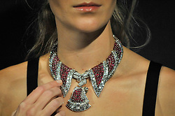 © Licensed to London News Pictures. 11/10/2017. London, UK. A model wears a 1950s ruby and diamond pendant necklace (Est. GBP120-150k) at a preview of a collection of English and continental silver and antique jewels from S.J. Phillips, one of London's oldest antique galleries.  The collection will be presented for sale by Sotheby's on 18 October in London. Photo credit : Stephen Chung/LNP