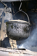 Georgia, Aragvi river valley Outdoor cooking pot simmers above a fire