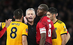 Wolverhampton Wanderers' Ruben Neves (left) and Manchester United's Paul Pogba appear to match referee Martin Atkinson during the FA Cup quarter final match at Molineux, Wolverhampton.