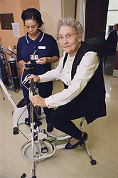 Elderly woman taking part in exercise regime for patients with respiratory disease,