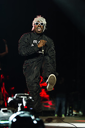 """© Licensed to London News Pictures. 05/09/2014. Isle of Wight, UK. Outkast performing live at Bestival 2014 Day 2 Friday.  In this picture - André """"André 3000"""" Benjamin.  Outkast are a hip hop duo consisting of rappers André """"André 3000"""" Benjamin and Antwan """"Big Boi"""" Patton.  This weekend's headliners include Chic featuring Nile Rodgers, Foals and Outcast.   Bestival is a four-day music festival held at the Robin Hill country park on the Isle of Wight, England. It has been held annually in late summer since 2004.    Photo credit : Richard Isaac/LNP"""