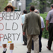 A protester walks up and down the sidewalk during the Republican National Convention in Tampa, Fla. on Wednesday, August 29, 2012. (AP Photo/Alex Menendez)