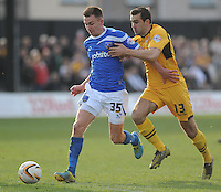 Portsmouth's Jed Wallace vies for possession with Newport County's Andy Sandell<br /> <br /> Photo by Ashley Crowden/CameraSport<br /> <br /> Football - The Football League Sky Bet League Two - Newport County AFC v Portsmouth - Saturday 29th March 2014 - Rodney Parade - Newport<br /> <br /> © CameraSport - 43 Linden Ave. Countesthorpe. Leicester. England. LE8 5PG - Tel: +44 (0) 116 277 4147 - admin@camerasport.com - www.camerasport.com