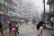 Morning fog in Charikot, district headquarters of Dolakha. School kids on their way to school and people rushing to work.