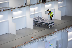 © Licensed to London News Pictures. 10/04/2020. Manchester, UK. A single bed in a patient bay in the hospital . The National Health Service is building a 648 bed field hospital for the treatment of Covid-19 patients , at the historical railway station terminus which now forms the main hall of the Manchester Central Convention Centre . The facility is due to open next week and will treat patients from across the North West of England , providing them with general medical care and oxygen therapy after discharge from Intensive Care Units . Photo credit: Joel Goodman/LNP