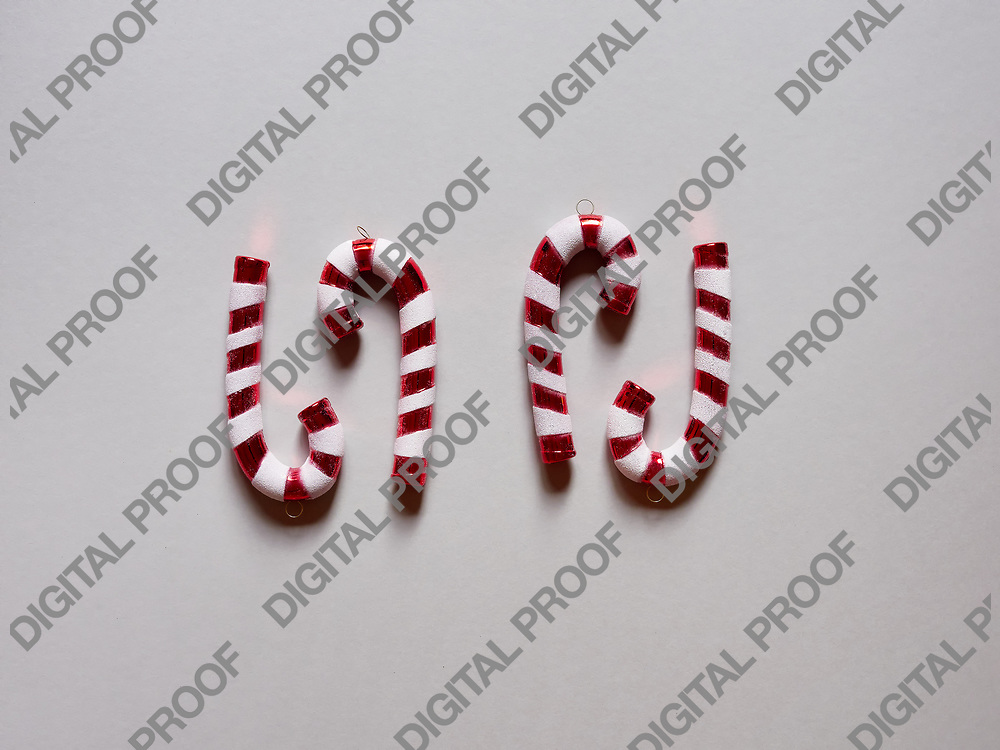 Christmas candy cane drums  at studio above view over a grey cream background isolated flatlay