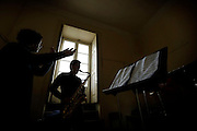 The Portuguese National School of Music is suffering from a lack of resources and the whole building is deteriorating at a rapid pace. Last year the school was forced to close 10 classrooms due to problems with water infiltrations in the ceilings and walls and since then students have not been able to prepare in best conditions for hearings and trials, despite the school's efforts.<br /> Meanwhile teachers, students and their parents created a social movement in order to pressure the Ministry of Education to unlock the promised funds for the building restoration.<br /> <br /> Teacher gives saxophone lessons to three students.<br /> (NO SALES IN PORTUGAL)