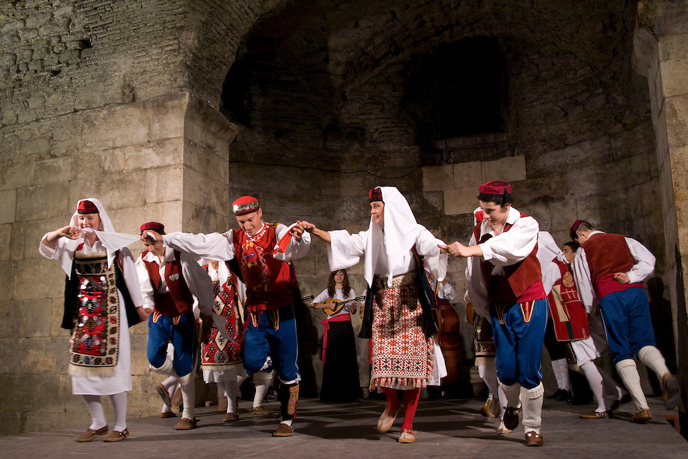 Europe, Croatia, Dalmatia, Split.  Folk dancers in traditional costumes perform in Diocletian's Palace.