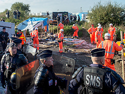 October 25, 2016 - London, Northern France, United Kingdom - Image ©Licensed to i-Images Picture Agency. 25/10/2016. London, United Kingdom. Demolition Begins at the Calais Jungle. CRS riot police and a digger move in to demolish makeshift shacks in the Calais Jungle. Picture by Pete Maclaine / i-Images (Credit Image: © Pete Maclaine/i-Images via ZUMA Wire)
