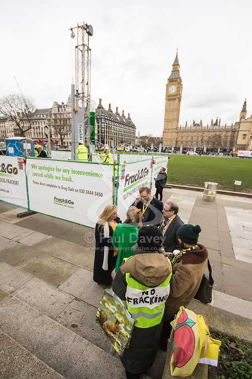 """Parliament Square, London, February 9th 2016. Anti-fracking protesters put a up a noisy, smoke-belching """"fracking site"""" in Parliament Square as a Parliamentary inquiry begins into fracking. ///FOR LICENCING CONTACT: paul@pauldaveycreative.co.uk TEL:+44 (0) 7966 016 296 or +44 (0) 20 8969 6875. ©2015 Paul R Davey. All rights reserved."""