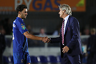 West Ham United manager Manuel Pellegrini shaking AFC Wimbledon defender Will Nightingale (5) hand during the EFL Carabao Cup 2nd round match between AFC Wimbledon and West Ham United at the Cherry Red Records Stadium, Kingston, England on 28 August 2018.