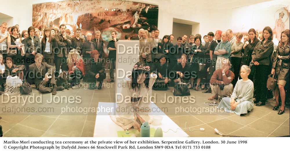 Mariko Mori conducting tea ceremony at the private view of her exhibition. serpentine Gallery. London. 30 June 1998<br /> © Copyright Photograph by Dafydd Jones<br /> 66 Stockwell Park Rd. London SW9 0DA<br /> Tel 0171 733 0108