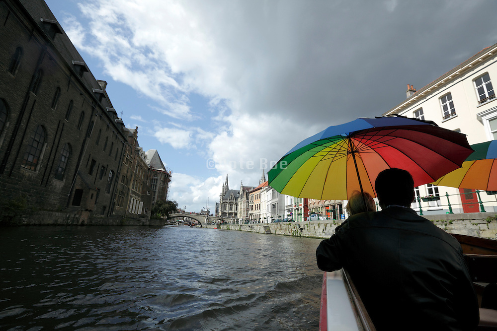 tourist boat ride on the Leie during a rainy day Gent Belgium