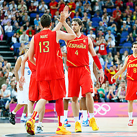 08 August 2012: Spain Marc Gasol is congratulated by Pau Gasol during 66-59 Team Spain victory over Team France, during the men's basketball quarter-finals, at the 02 Arena, in London, Great Britain.