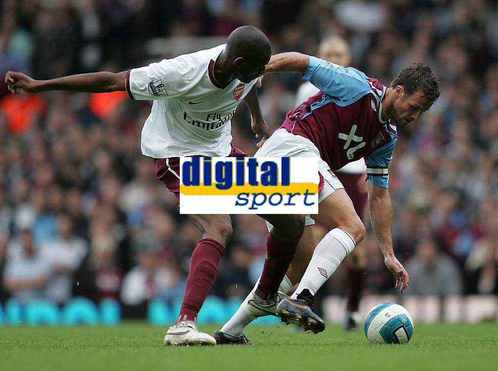 Photo: Lee Earle.<br /> West Ham United v Arsenal. The FA Barclays Premiership. 29/09/2007. West Ham's Lucas Neill (R) battles with Vassiriki Diaby.
