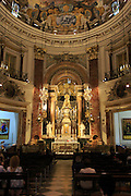 Ornately decorated altar inside cathedral church building building, city of Valencia, Spain
