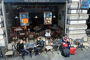 As Covid pandemic restrictions continue to ease, and non-essential retail businesses begin to re-open their shops, coffee drinkers sit outside the Piccadilly branch of Caffee Nero, 18th April 2021, in London, England.