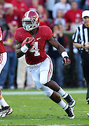 TUSCALOOSA, AL - NOVEMBER 10:  Running back T.J. Yeldon #4 of the Alabama Crimson Tide runs with the ball during the game against the Texas A&M Aggies at Bryant-Denny Stadium on November 10, 2012 in Tuscaloosa, Alabama.  (Photo by Mike Zarrilli/Getty Images)