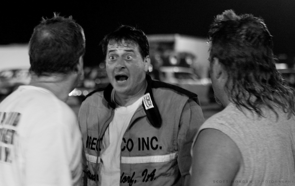 Scott Morgan/The Hawk Eye.Josh Foster, left, Darin Thye 11d , Elmer Arnold, 10a, right..Saturday Aug. 26, 2006 at the 34 Raceway in Middletown, Iowa.