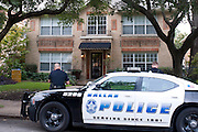 Police officers sit outside an apartment where a second Ebola patient has been reported in Dallas, Texas on October 12, 2014. (Cooper Neill for The New York Times)