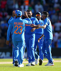India's Mohammed Shami (centre) and team mates celebrate their win over Afghanistan during the ICC Cricket World Cup group stage match at the Hampshire Bowl, Southampton.