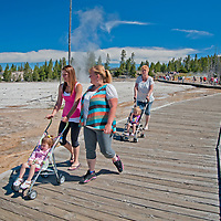 Tourists crowd the boardwalks at Lower Geyser Basin in Wyoming's Yellowstone National Park.