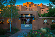 "Santa Fe is the capital of the state of New Mexico. This area was occupied for at least several thousand years by indigenous peoples who built villages several hundred years ago on the current site of the city. It was known by the Tewa inhabitants as Ogha Po'oge (""White Shell Water Place""). The city of Santa Fe, founded by Spanish colonists in 1610, is the oldest city in the state and the oldest state capital city in the United States. Santa Fe (meaning ""holy faith"" in Spanish) had a population of 69,204 in 2012.  After the mainline of the railroad bypassed Santa Fe, it lost population. However artists and writers, as well as retirees, were attracted to the cultural richness of the area, the beauty of the landscapes, and its dry climate. Local leaders began promoting the city as a tourist attraction. The city sponsored architectural restoration projects and erected new buildings according to traditional techniques and styles, thus creating the Santa Fe Style. Edgar L. Hewett, founder and first director of the School of American Research and the Museum of New Mexico in Santa Fe, was a leading promoter. He began the Santa Fe Fiesta in 1919 and the Southwest Indian Fair in 1922 (now known as the Indian Market)."