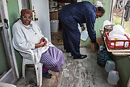 Roy Bowman delivering clean water to Viola Marshall, one of the elders in town he and his wife make sure have water on a regular basis. Gov. John Bell Edwards made an emergency health proclamation on December 16, 2016, enabling a fast-tracked replacement of St. Joseph's water system after lead was found in the water.
