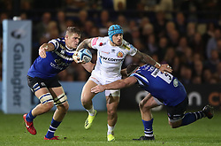 Exeter Chiefs' Jack Nowell runs between Bath Rugby's Henry Thomas (right) and Tom Ellis (left) during the Gallagher Premiership match at the Recreation Ground, Bath.