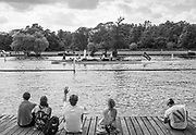 """Henley. Berks, United Kingdom. <br /> <br /> Spectators, on the slipway of Upper Thames RC.  watch as the Umpires Launch, """"Consulta"""" passes Upper Thames RC. 2017 Henley' Women's Regatta. Rowing on, Henley Reach. River Thames. <br /> <br /> <br /> Saturday  17/06/2017<br /> <br /> <br /> [Mandatory Credit Peter SPURRIER/Intersport Images]"""
