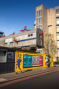 Jogger running past the closed Vinegar Yard, an urban garden normally open seven days a week, with food stalls and bars on 16th April 2020 in London, United Kingdom. Normally crowded with people London is like a ghost town as workers stay home under lockdown during the Coronavirus pandemic. The train carriage installation is by Joe Rush, famous for his scrap-metal sculptures at  the Glastonbury Festival.