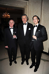 Left to right, trainer JOHN OXX, ARNAUD BAMBERGER and CHRISTOPHER TSUI at the Cartier Racing Awards 2009 held at Claridge's, Brook Street, London on 17th November 2009.