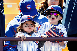 March 18, 2018 - Las Vegas, NV, U.S. - LAS VEGAS, NV - MARCH 18: Two young Cubs fans watch the team warm up prior to a game between the Chicago Cubs and Cleveland Indians as part of Big League Weekend on March 18, 2018 at Cashman Field in Las Vegas, Nevada. (Photo by Jeff Speer/Icon Sportswire) (Credit Image: © Jeff Speer/Icon SMI via ZUMA Press)