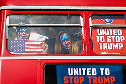 """London, September 21st 2016. A """"Stop Trump"""" open topped red London double-decker bus tours central London in a bid to encourage US expats to register to vote, expecting the majority of them to be more inclined to support for Hilary Clinton."""