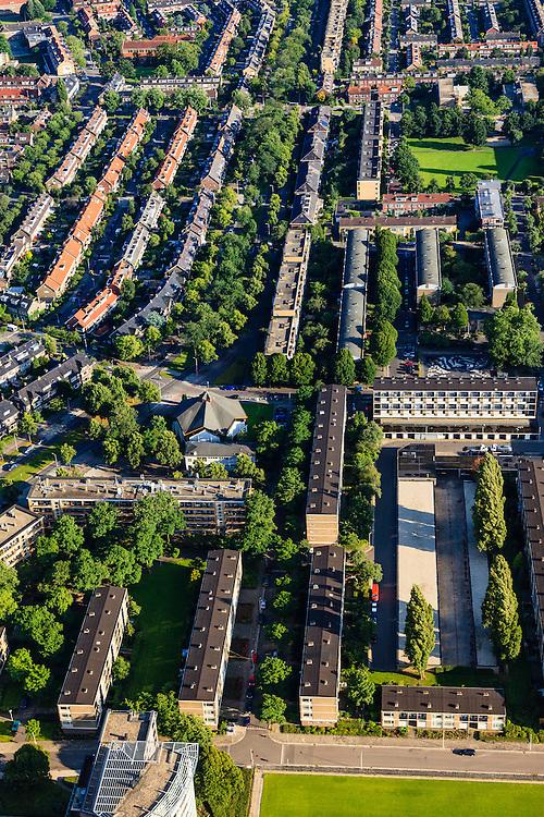 Nederland, Utrecht, Utrecht, 15-07-2012; de wijk Halve Maan, direct naast het Amsterdam-Rijnkanaal. De wijk maakt onderdeel van uit van het stadsdeel Oog en Al en stamt uit de  jaren vijftig, de wederopbouwperiode. Kenmerkend zijn laagbouw en portiek-flats. Onder in beeld Sportpark Marco van Basten, midden Herderplein, Pnielkerk, boven het midden het Hugo de Grootplein..Halve Maan (Crescent) neighborhood, part of district Eye and Al. Low-rise flats and single-family houses. The neighborhood dates from the fifties, the post-war reconstruction period..luchtfoto (toeslag), aerial photo (additional fee required).foto/photo Siebe Swart