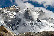 The daunting south face of Lhotse (27,940 feet), the world's fourth highest peak, rises impressively at Chhukhung teahouse, Nepal, Himalaya Mountains, Asia. The south face of Lhotse rises 3.2 km (1.98 mi) in only 2.25 km (1.4 mi) of horizontal distance (55 degree angle slope), making it the steepest face of this size in the world. Sagarmatha National Park was created in 1976 and honored as a UNESCO World Heritage Site in 1979.