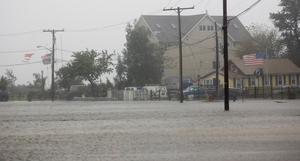 (PPAGE1) Union Beach  9/2/2006   Water surged past homes and onto Union Ave in Union Beach.    Michael J. Treola Staff Photographer.....MJT