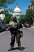 A soldier dressed in hazmat biochemical protection guards the US Capitol building during a drill, Washington, DC