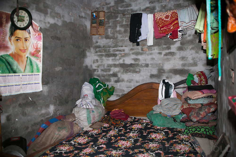 The one room lodging where Jalal lives with his wife and four daughters. There bed fills most of the room leaving a small space at the end of the bed for a cabinet and room for Jalal to sleep at night. He sleeps on the floor while his wife and daughters sleep on the bed together.