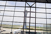 China, Beijing Capital Airport August 2008. An Air China passenger plane can be seen through the window