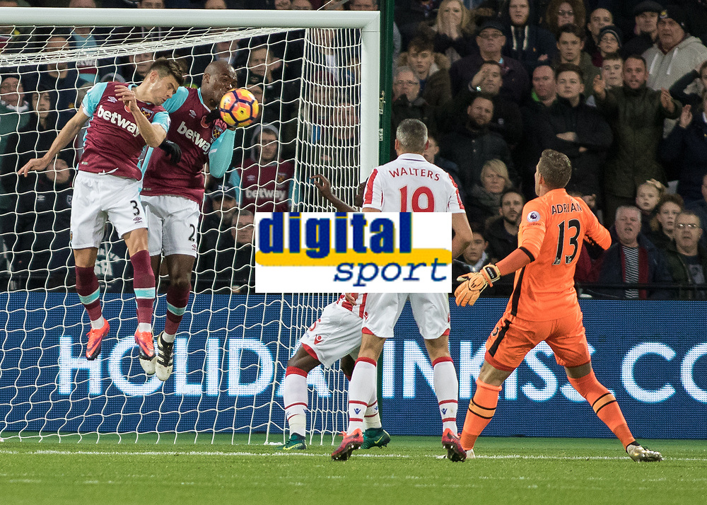 Football - 2016 / 2017 Premier League - West Ham United vs. Stoke City<br /> <br /> Desperate defending by West Ham defenders Aaron Cresswell and Angelo Ogbonna as they clear the ball off the empty goal at The London Stadium.<br /> <br /> COLORSPORT/DANIEL BEARHAM