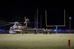August 18, 2018 - Wellington, Florida, U.S. - A shooting victim is taken to Trauma Hawk. Two adults were shot Friday night at a football game between Palm Beach Central and William T. Dwyer high schools, authorities said. The gunfire sent players and fans screaming and stampeding in panic during the fourth quarter of the game at Palm Beach Central High School in Wellington, Florida on August 17, 2018. (Credit Image: © Allen Eyestone/The Palm Beach Post via ZUMA Wire)