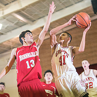 121714  Adron Gardner/Independent<br /> <br /> Bernalillo Spartan David Romero (13), left, pressures Grants Pirate Matt Vail (41) on a drive to the basket during a Throwback matchup at Grants High School Wednesday.
